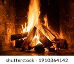 A Fire Burns In A Fireplace ...