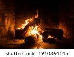 a fire burns in a fireplace ... | Shutterstock . vector #1910364145