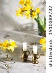 Two Candles With Daffodil...