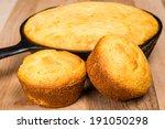 Stock photo cornbread muffins and cornbread pone in an iron skillet 191050298