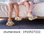 Girls' legs on white bed...