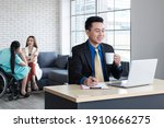 Businessman Sitting On...