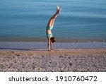 A Teenage Girl Does Gymnastic...