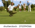 Male Golfer And Partners Happy...