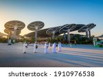 Small photo of Dubai, United Arab Emirates - February 4, 2020: Emirati entertainers in front of Terra Sustainability Pavilion at the EXPO 2020 at sunset built for EXPO 2020 scheduled to be held in 2021 in the UAE