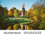 Windmill In A Park With Many...