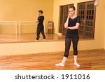 ballerina standing in studio | Shutterstock . vector #1911016
