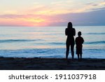 Silhouette Of Mother And Sun...