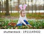 Girl Wearing Bunny Ears Playing ...
