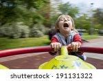 Child On Merry Go Round