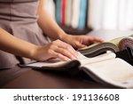 fabric shop. woman at street... | Shutterstock . vector #191136608
