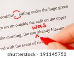 Stock photo red pen used to proofread text in story closeup 191145752
