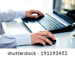 Businessman With Computer In...
