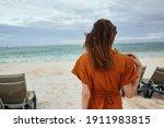 Woman In Orange Sundress Near ...