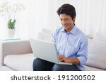 happy man sitting on couch... | Shutterstock . vector #191200502