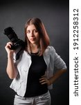 Woman Photographer With A Slr...