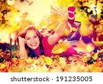 cute pretty girl in an autumn... | Shutterstock . vector #191235005