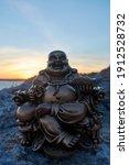 Buddha Figure  At Sunset  On A...
