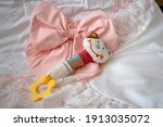 a baby rattle with a pink bow... | Shutterstock . vector #1913035072
