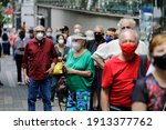 Small photo of Sao Paulo, SP, Brazil - February 9, 2021: People wait in a big line to vaccinate against COVID-19 during a priority vaccination program for elderly people.