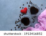 A Pair Of Black Coffee Cups In...