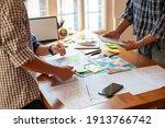 a team of web designers design...