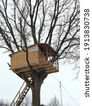Wooden Treehouse Built On A...