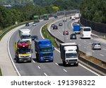trucks on a three lane motorway.... | Shutterstock . vector #191398322