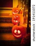 Three Jack O Lanterns Sit On A...