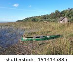 Green Boat And A Small Wooden...