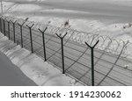 Sharp Razor Wire On Mesh Fence. ...