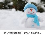 Cute Small Snowman Toy On Snow...