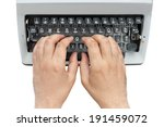 Hands on a typewriter keyboard shot from above isolated on white background with clipping path - stock photo