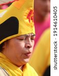 Asian Female Monk Priest With...