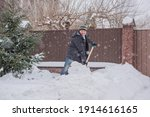 Snow Collapse  Man Cleaning...
