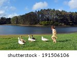 Little Girl Chasing Wild Ducks...