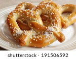 Freshly baked soft pretzels with generous sprinkling of coarse salt.  Closeup with shallow dof. - stock photo