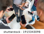 Small photo of group of student holding smartphone in hands, many cellphone and people having addiction on social network and app, millennial generation behavior of social segregation