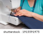 Cheerful Woman Sewing While...