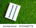 White Notebook On A Green Grass ...