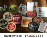 Small photo of ROUND ROCK, TEXAS - MARCH 19, 2018: Shiner Bock Coasters. A group of assorted coasters from the Spoetzl Brewery, the oldest independent brewery in Texas.