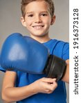 Cheerful Boy Putting On Boxing...