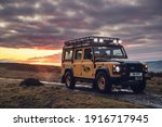 Small photo of California, USA - January 10, 2021: A yellow Land Rover Classic Defender Works V8 Trophy is parked on road