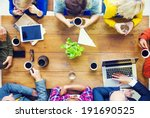 Small photo of Multiethnic People with Startup Business Talking in a Cafe