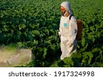 Gardener In A Protective Suit...