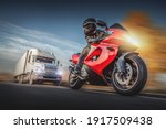 Small photo of Motorcyclist escapes of the chase of a road truck.