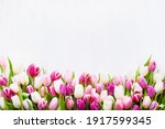 Pink And White Tulips On A...