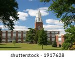 Beautiful campus clocktower with cloudy sky - stock photo