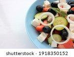 greek salad in blue bowl on... | Shutterstock . vector #1918350152