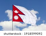 Nepal flag isolated on the blue ...